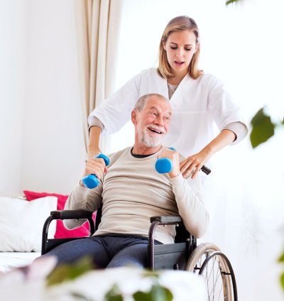 caregiver assisting elder man in his exercise
