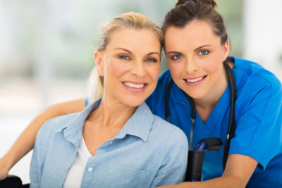 nurse and woman smiling