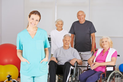 group of elderly and nurse smiling